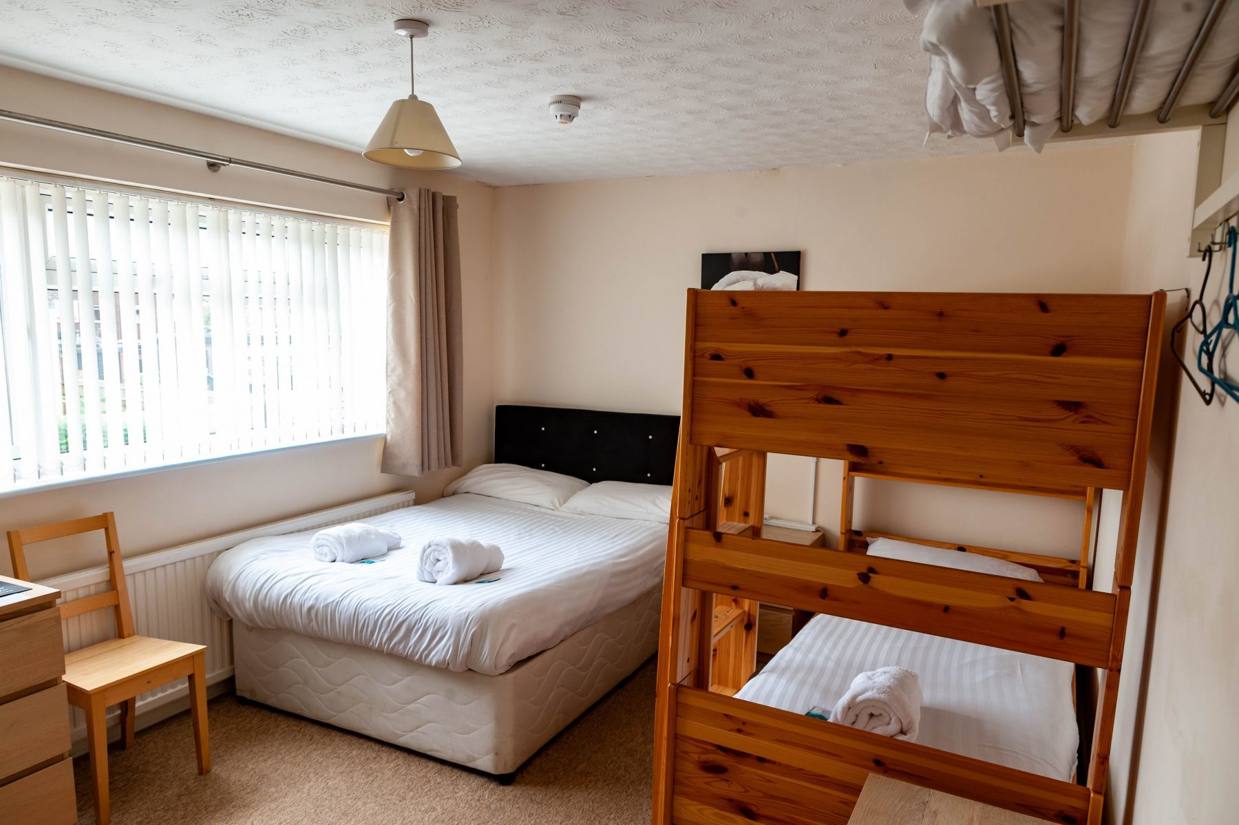 Triple room. One standard double bed and a bunk bed (two single size beds), located upstairs